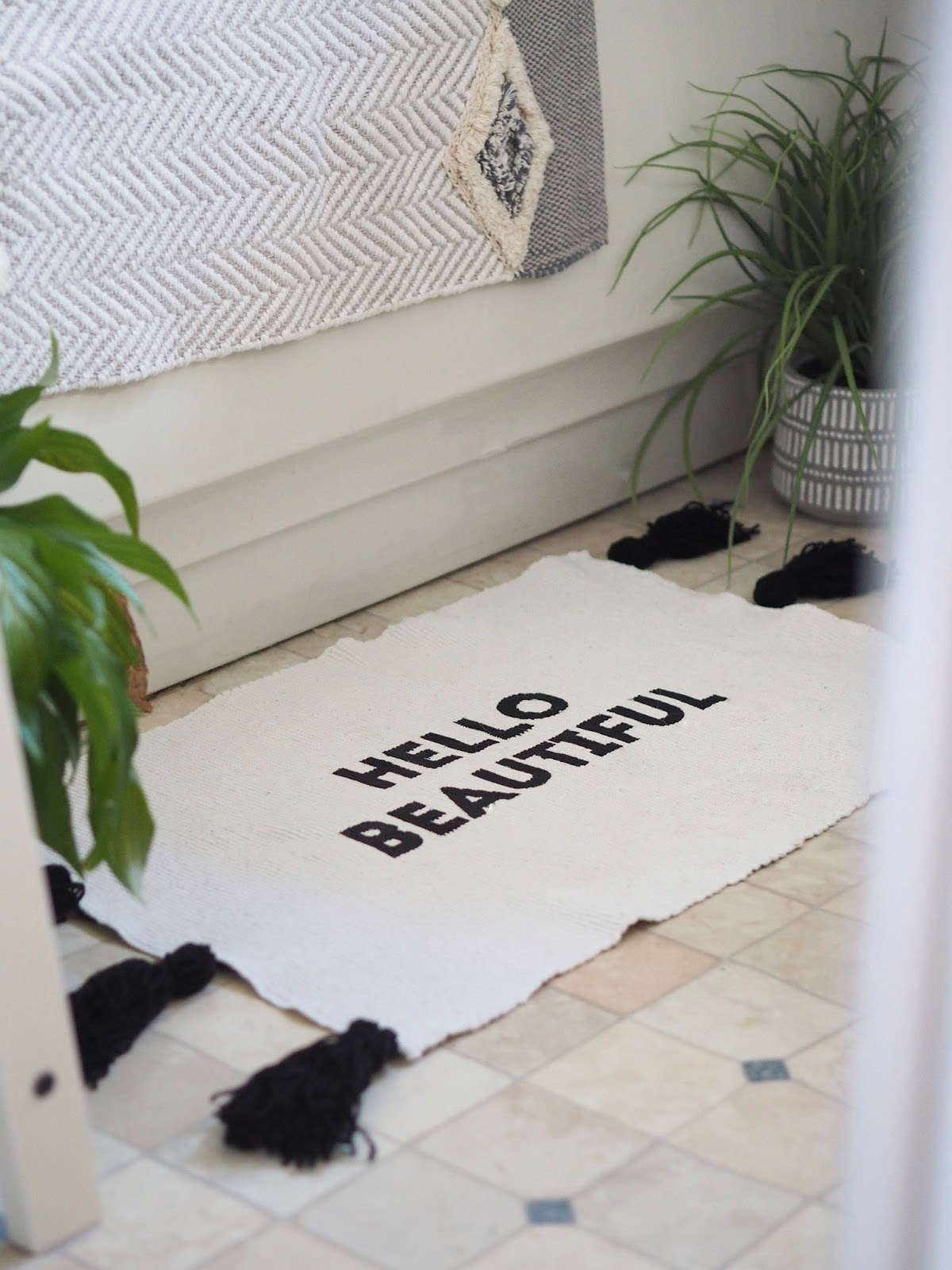DIY slogan bath mat with fabric paint and woollen tassels from a cheap dollar store bath mat. Budget easy, quick DIY craft tutorial to create stylish bathroom decor and interiors