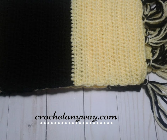 yellow and black crochet scarf