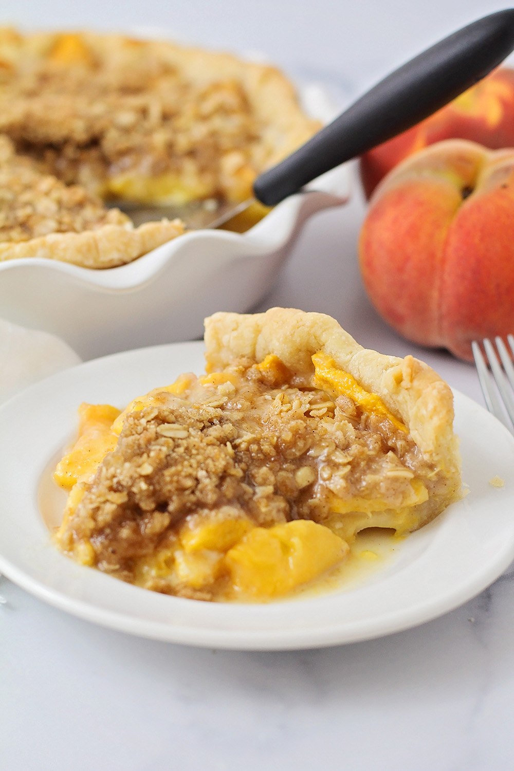 This peach crisp pie is loaded with juicy fresh peaches, all covered with buttery cinnamon crisp topping!