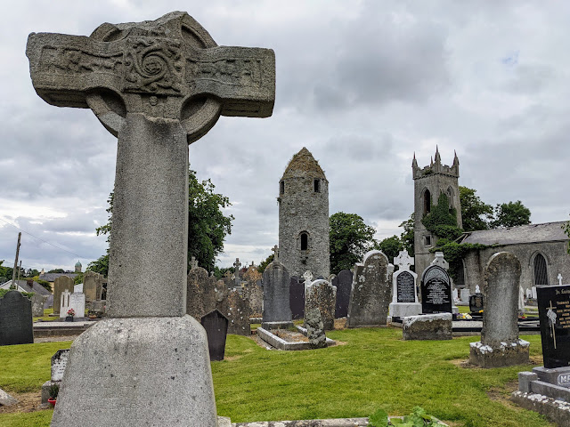 Celtic cross and round tower at Dromiskin Monastery in County Louth Ireland