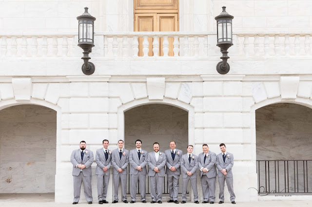 groomsmen in front of detroit institute of arts posing