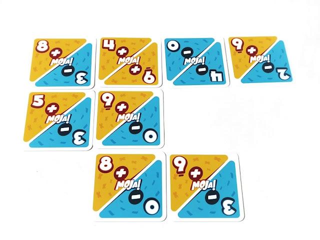 na zdjęciu karty z działaniami ułożone w kilka rzędów i kolumn