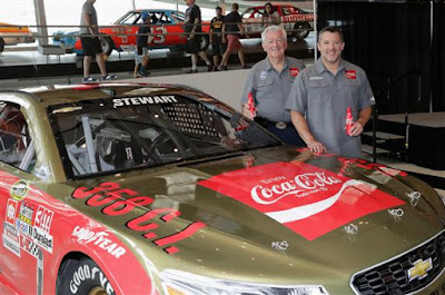 Bobby Allison and Tony Stewart pose for pictures with the car's new paint scheme