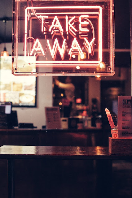 Takeaway neon sign. Photo by Clem Onojeghuo on Unsplash