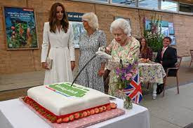 Queen cutting a cake with a sword