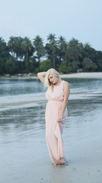 Fashion and Travel Blogger GlobalFashionGal (Brianna Degaston) wearing a blush Anthropologie maxi dress in Bintan Island, Indonesia.
