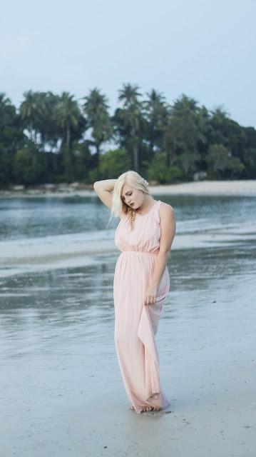 Fashion and Travel Blogger GlobalFashionGal (Brianna Degaston) wearing a blush Anthropologie maxi dress in Bintan Island, Indonesia.