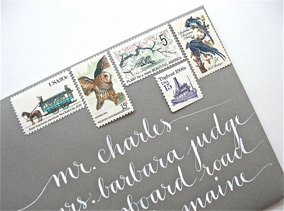 vintage stamps on a wedding invitation with calligraphy