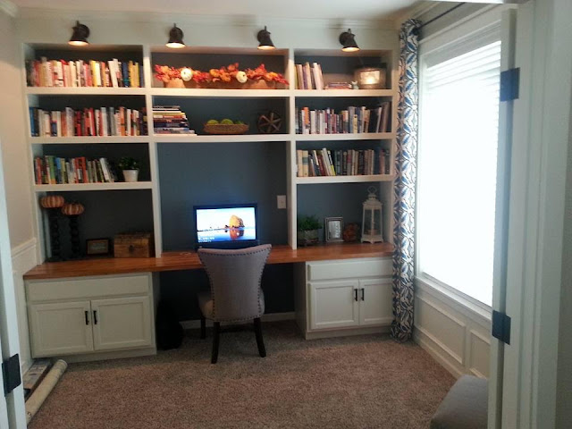 wall of bookcases with desk