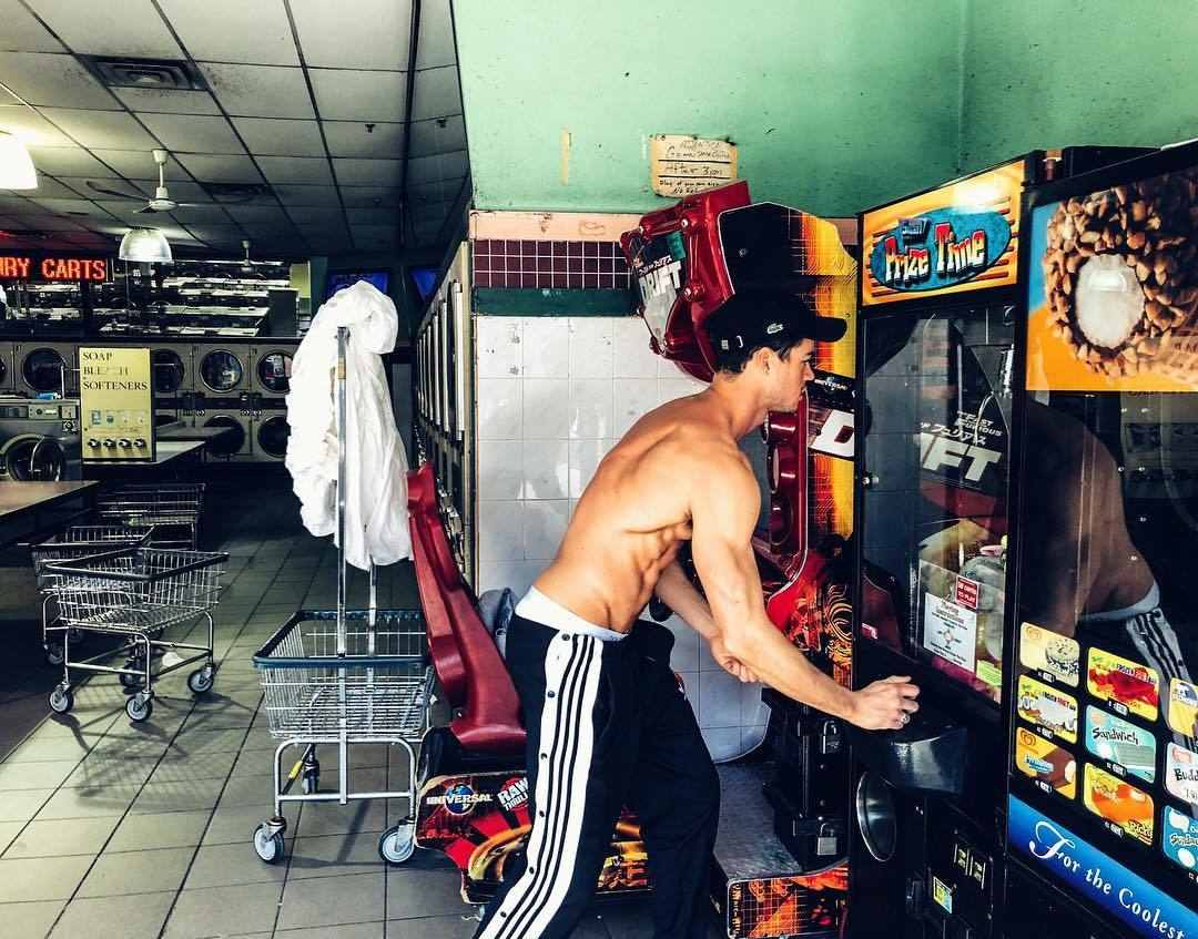 shirtless-fit-hot-guys-playing-games-pictures-laundry-wash-shop