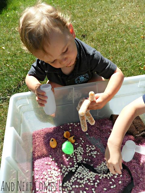 Toddler exploring Gruffalo sensory bin activity