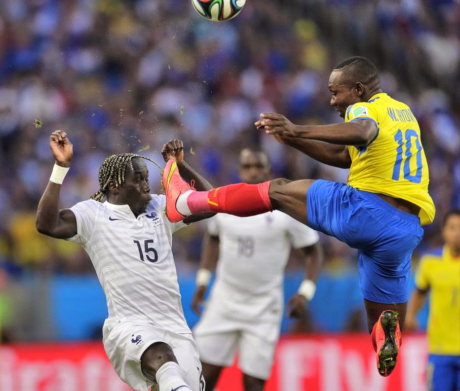 Ecuador's Walter Ayovi kicks the ball away in front of France's Bacary Sagna during the group E World Cup soccer match between Ecuador and France at the Maracana Stadium in Rio de Janeiro, Brazil, Wednesday, June 25, 2014.