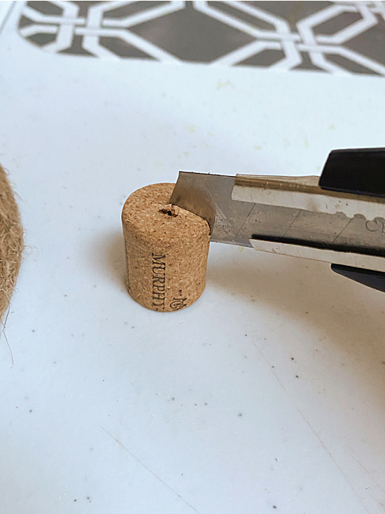 cutting a cork with a craft knife
