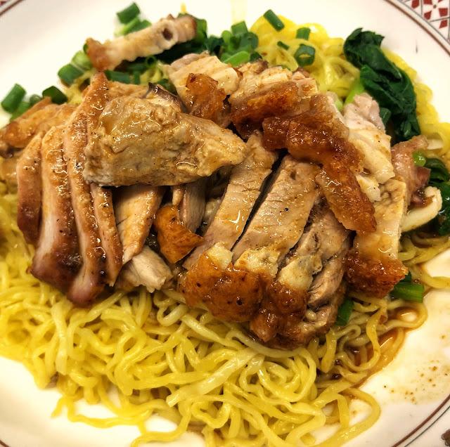phed-daeng-krob, or egg noodles with roasted duck, red pork, and crispy pork