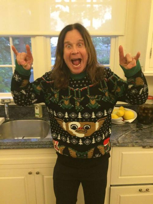 Ozzy Osbourne wearing an ugly Christmas sweater