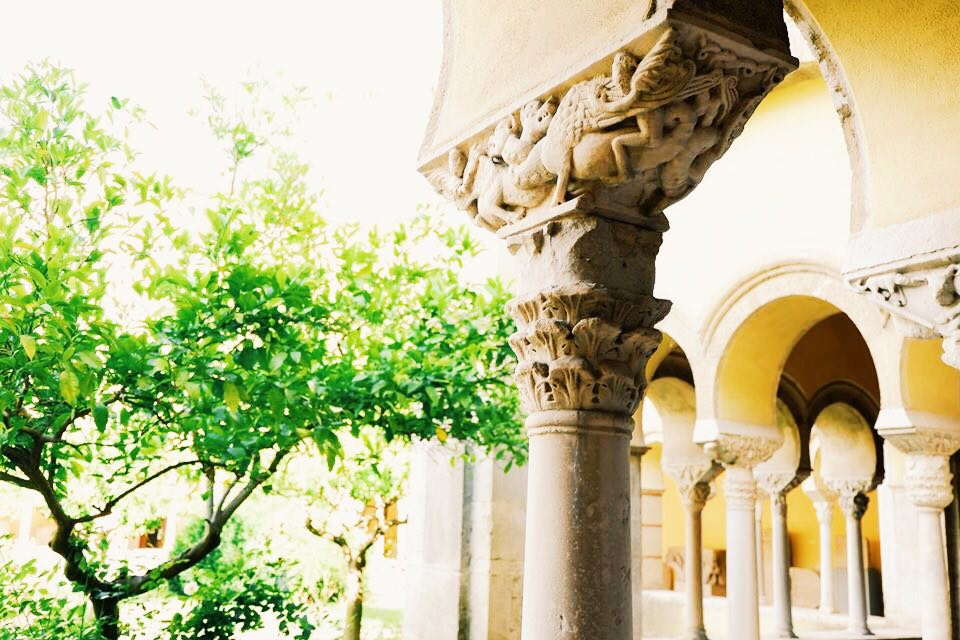 A pillar with intricate carvings in the cloister of the Museum Sannio in Benevento