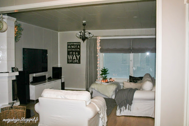 huonekuusi olohuone harmaa sisustus