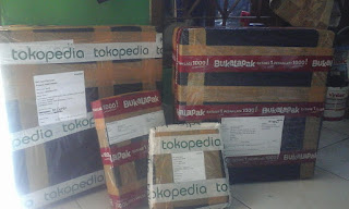 Packing Barang menggunakan Selotip Solasi Lakban TOkopedia