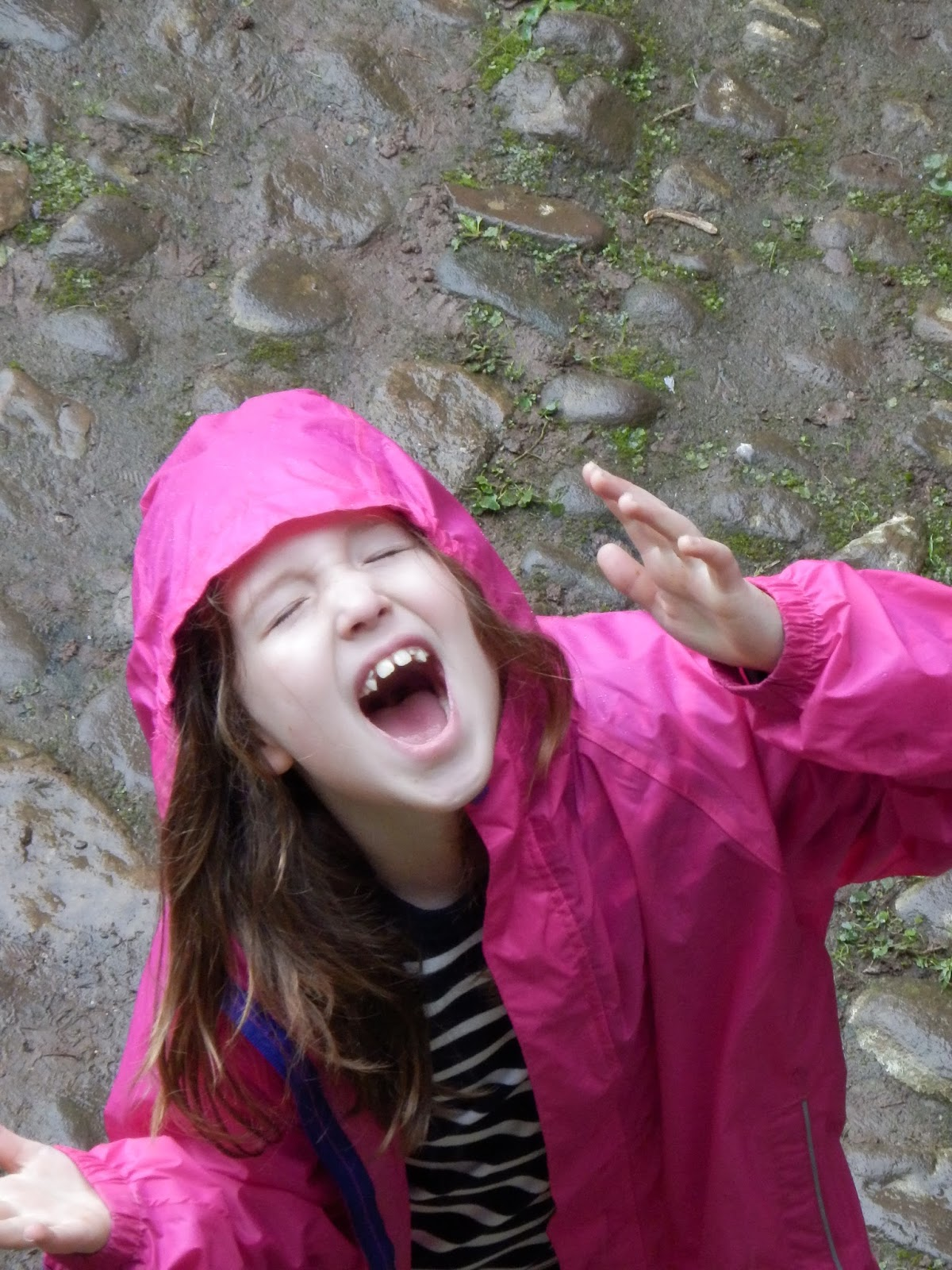 Caitlin with rain falling on her face at Raglan Castle