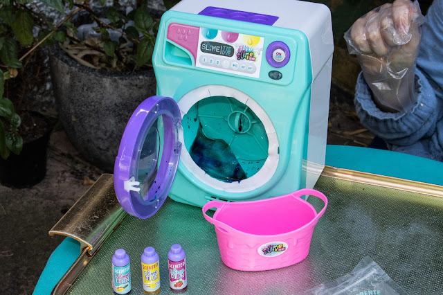 The slime machine with the door open showing freshly coloured tie-die slime inside