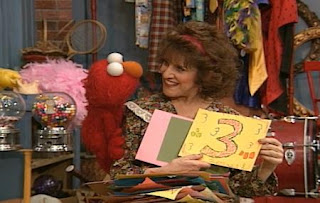 Ruthie asks some questions from pictures to Elmo and she wants to learn numbers in the picture. Sesame Street The Best of Elmo