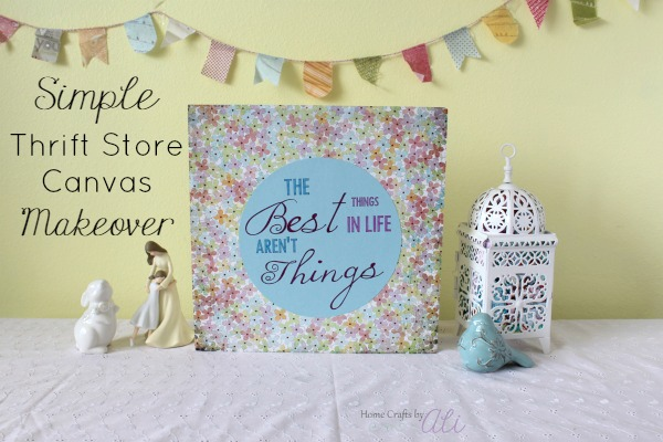 use scrapbook paper and your Cricut Machine to makeover a canvas from a thrift store