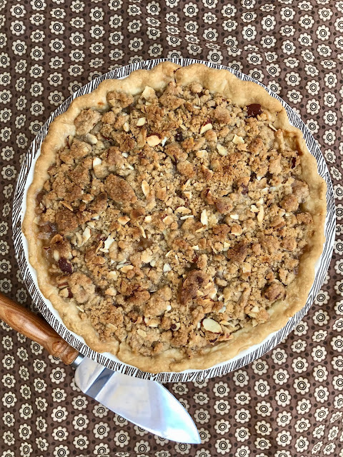 Finished pear almond crumble pie in the pie plate.