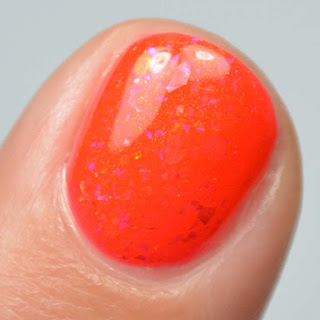 hot red nail polish with shimmer and flakies