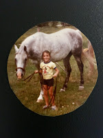 Nicole Rovig leading a horse as a child
