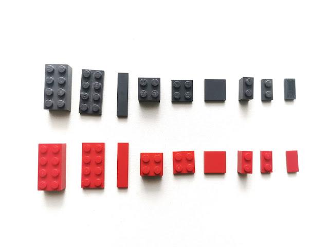 klocki lego w dwóch kolorach , róznych kształtach i wielkościach leża ułożone na stole w dwóch rzędach