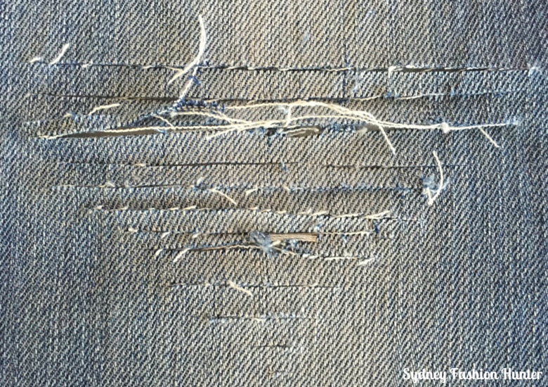 DIY Destroyed Jeans - Triangular Hole Cuts