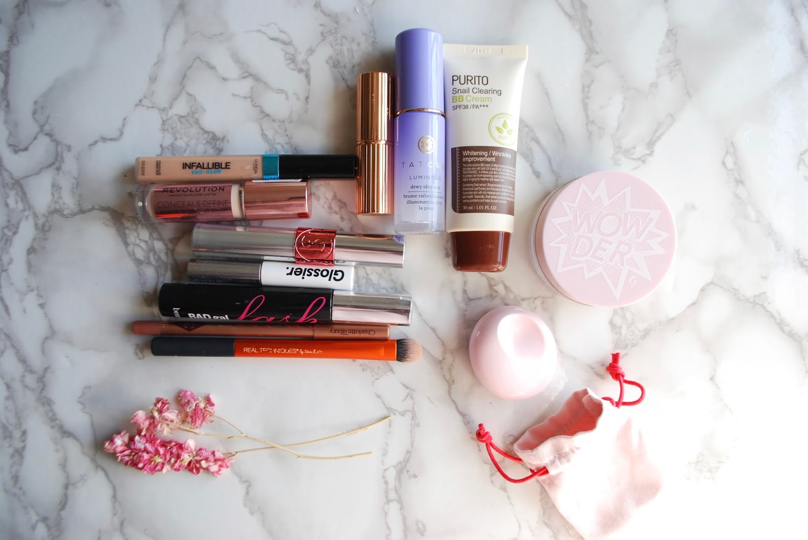 a peek inside my on-the-go makeup bag