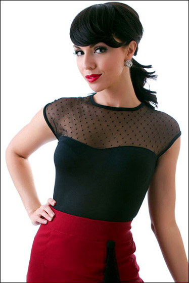 c7833bb4d6f Cute new rockabilly top! This Black Mesh Top with Polka Dots from Rock  Steady Clothing has darling cap sleeves and a keyhole opening in the back.