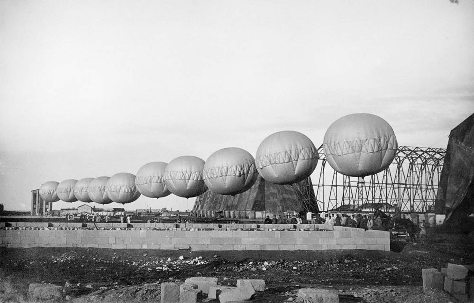 A row of barrage balloons used for suspending aerial nets in Brindisi, Italy. 1918.