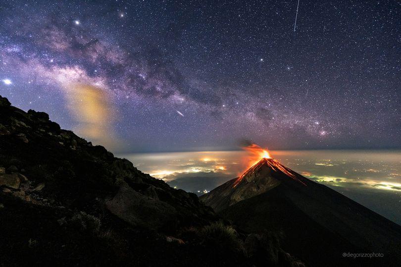 NASA Captures Stunning Photo of VOLCANO Erupting Beneath The Milky Way