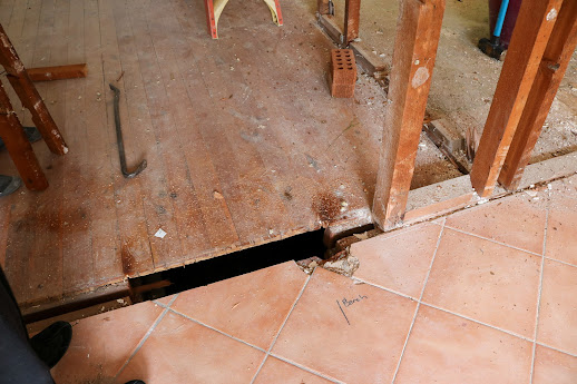 Taking up floor tiles by hand