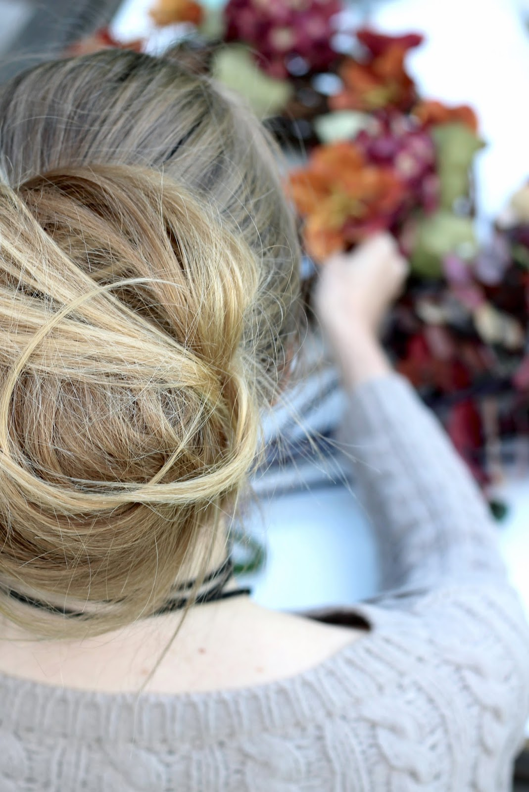 Blonde messy bun with very long hair