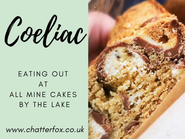 Image title reads coeliac eating out at all mine cakes by the lake. Image to the right shows a close up image of a homemade gluten free chocolate biscuit bar slice.