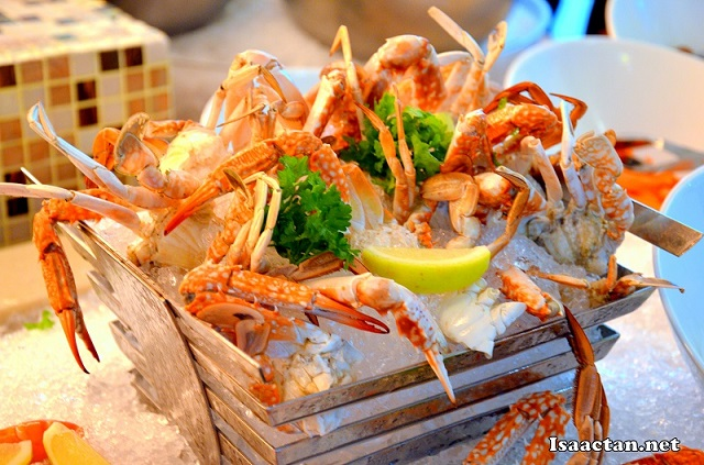 More fresh seafood on ice, this time a basket full of crabs