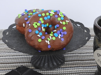 Chocolate frosted doughnuts with sprinkles