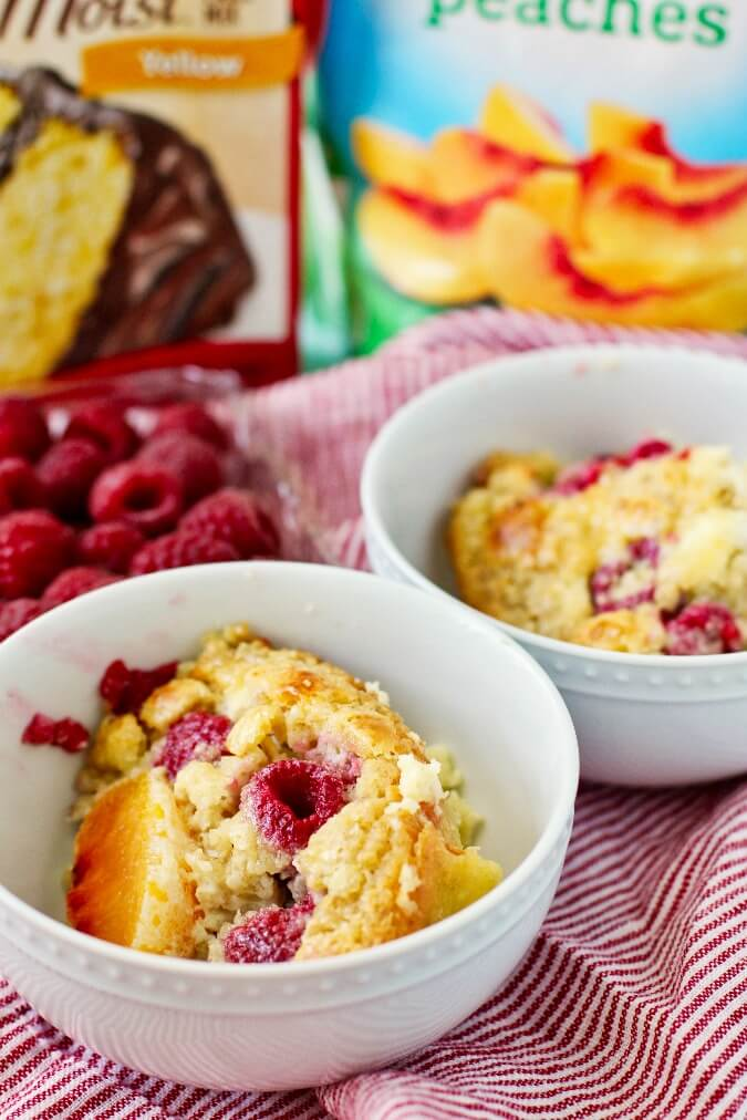 Yellow cake baked oatmeal with peaches and raspberries