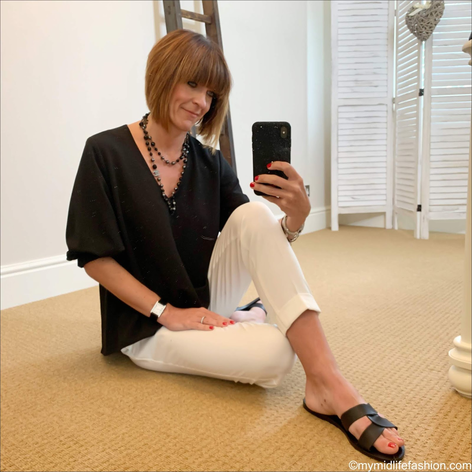 my midlife fashion, Chanel pearl necklace, tibi blouse, marks and Spencer peg leg tapered trousers, Ancient Greek desmos leather slides