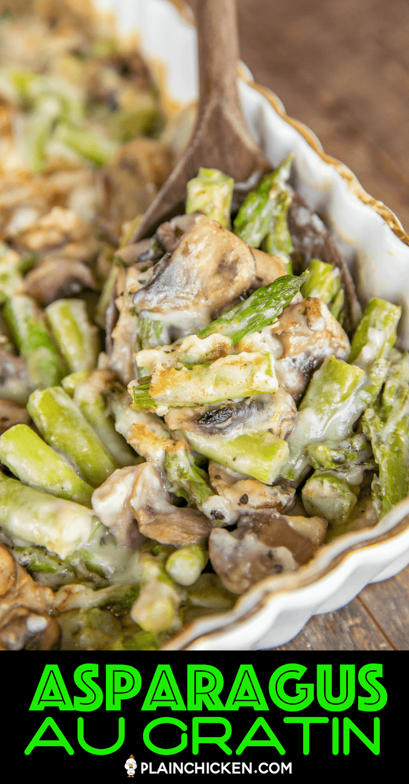 scooping cheesy asparagus and mushrooms from baking dish
