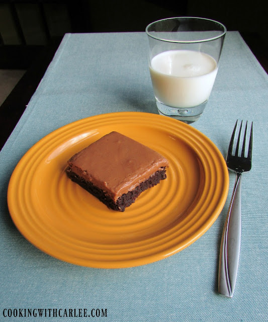 french silk brownie on plate with glass of milk