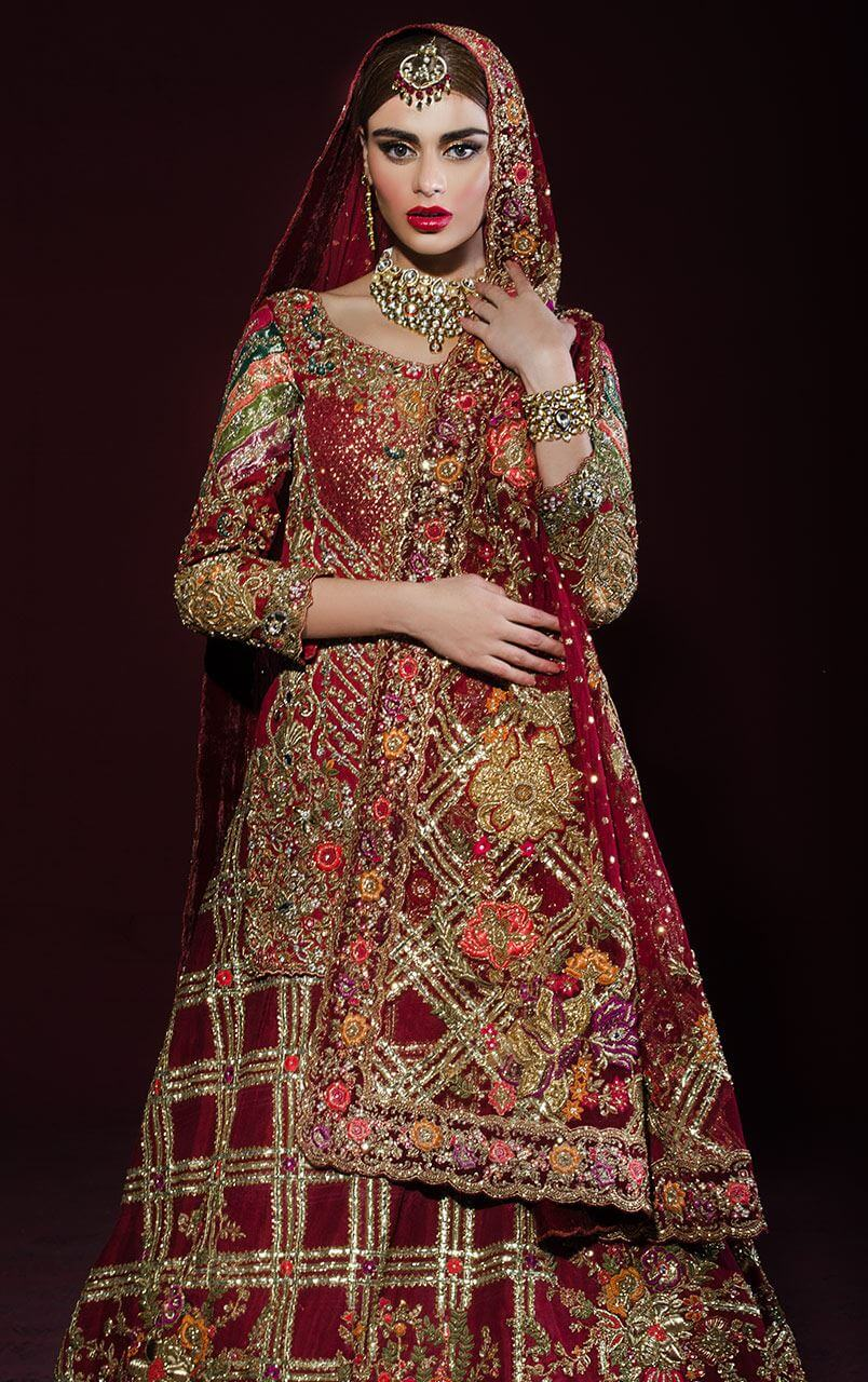 Red bridal short shirt heavily handworked with gold dabka, nakshi and embellished with beautiful coloured floral motifs