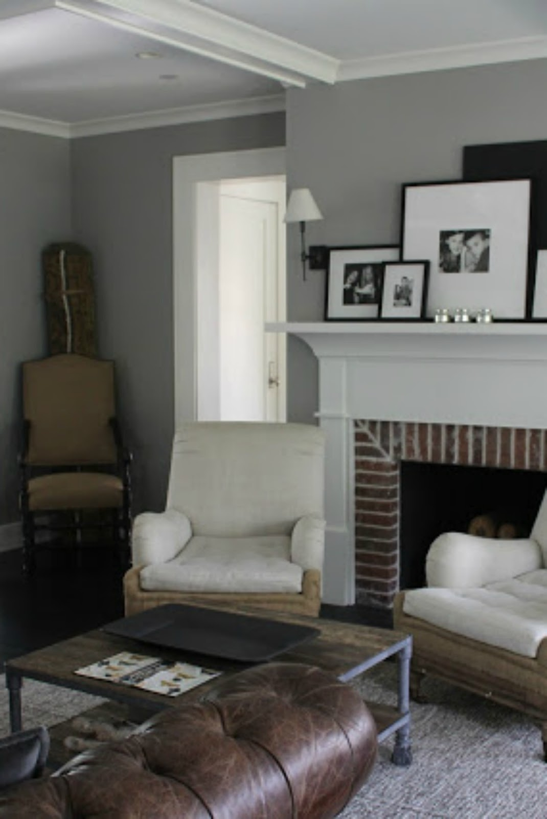 Modern farmhouse living room with red brick fireplace and grey walls on Hello Lovely Studio