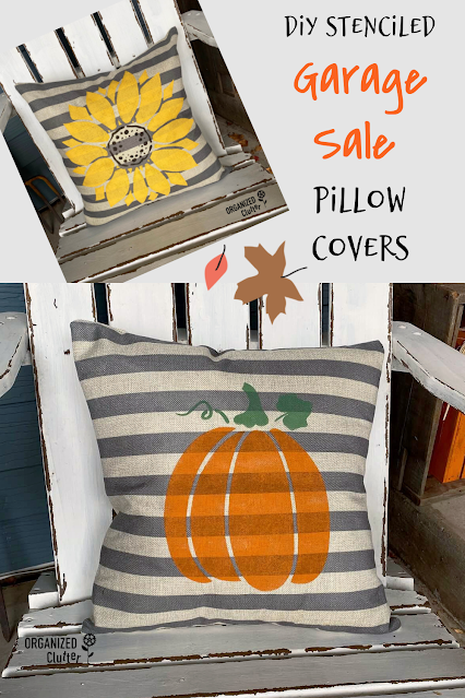 Photo of a striped pillow stenciled with a pumpkin and a sunflower.