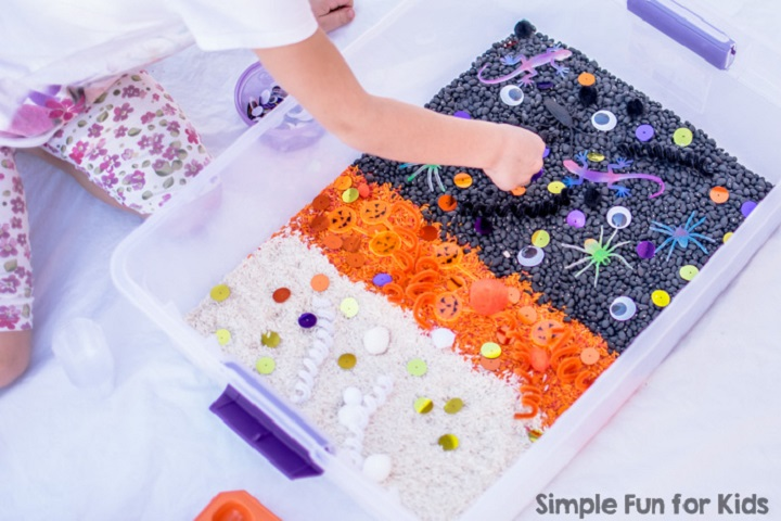 halloween themed sensory bin with rice and black beans