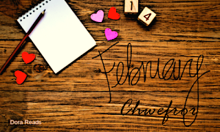 'February - Chwefror' against a desk background with a notepad and scattered hearts