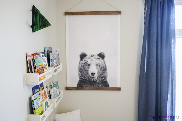 Reading Nook for a small space with art, seating, and wall mounted bookshelves